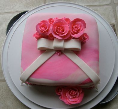 Pink gift box birthday cake with roses